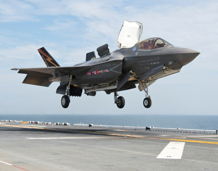 130814-O-ZZ999-280 ATLANTIC OCEAN (Aug. 14, 2013) An F-35B Lightning II aircraft lands aboard the amphibious assault ship USS Wasp (LHD 1) during the second at-sea F-35 developmental test event. The F-35B is the Marine Corps variant of the Joint Strike Fighter and is undergoing testing aboard Wasp. (U.S. Navy photo courtesy of Lockheed Martin by Andy Wolfe/Released)/Released)