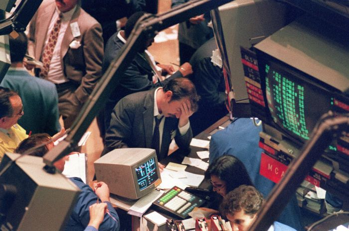"""FILES - Picture taken 19 October 1987 shows a trader holding his head at the floor of the New York Stock Exchange when the Dow Jones dropped over 500 points, the largest decline in modern time, as panic selling swept Wall Street. The 19 October 2007 marks the 20th anniversary of the so-called """"Black Monday"""", when the Dow Jones Industrial Average stock barometer plunged a dramatic 22.61 percent to 1,738.41 points. AFP PHOTO MARIA BASTONE (Photo credit should read MARIA BASTONE/AFP/Getty Images)"""