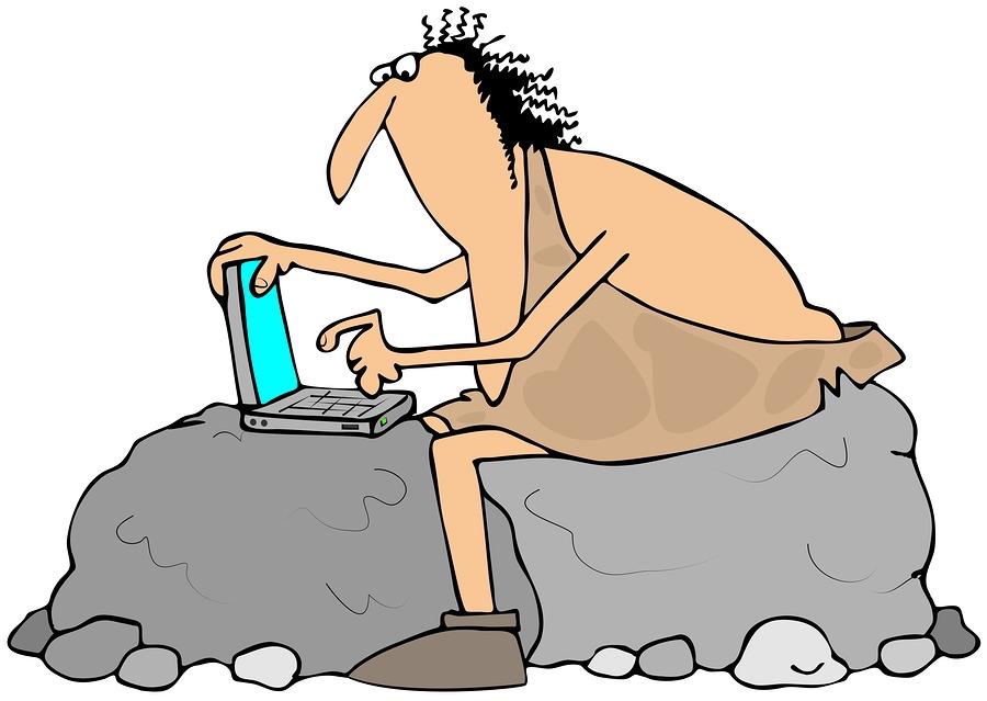 Caveman using a laptop computer