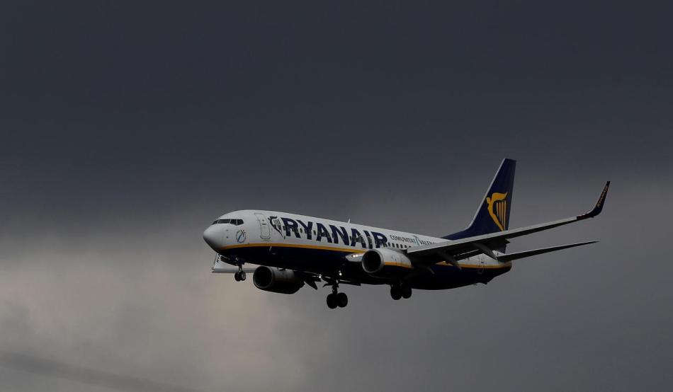 FILE PHOTO:A Ryanair plane prepares to land at Manchester Airport in Manchester